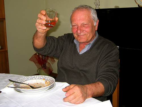 Vito Michele holding up a glass of homemade (his) wine